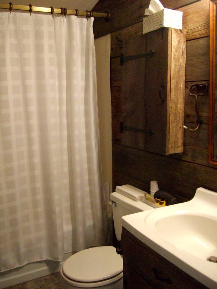 Full bath finished with barn board siding.